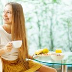 Woman Holding Tea at Breakfast